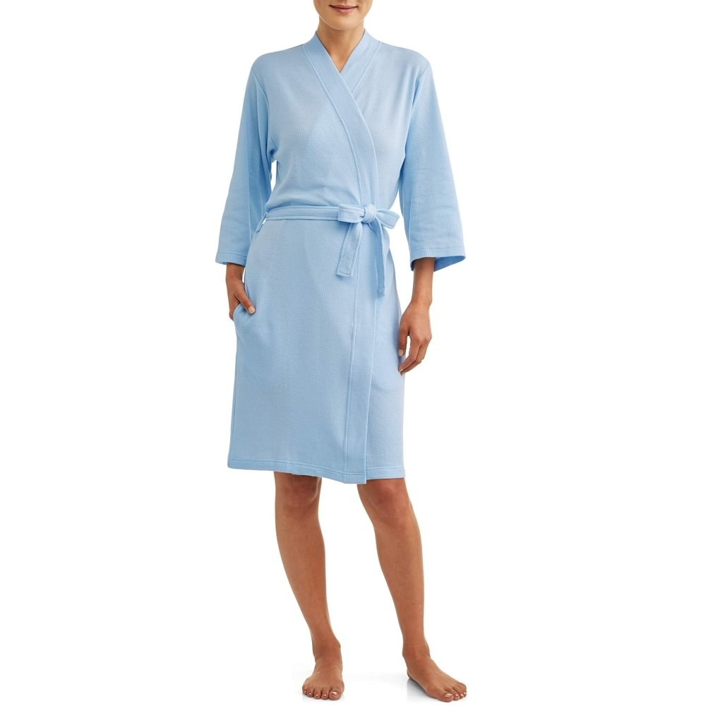 model wears waffle knit blue colored robe