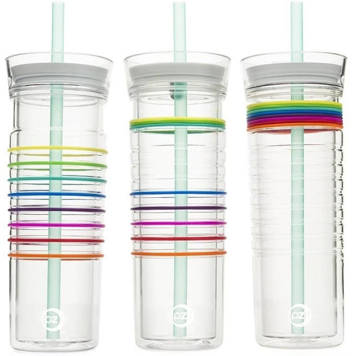 Three of the same water tumbler showing the colorful bands at various stages, pushed up to track how much water has been drunk