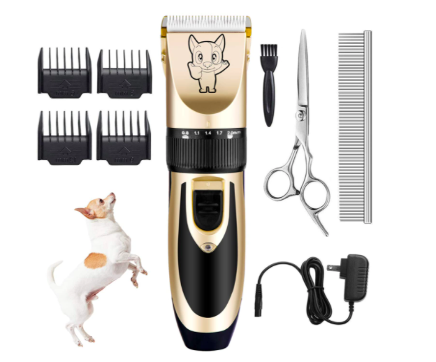 Razor clippers with cartoon dog alongside scissors, comb, and charger
