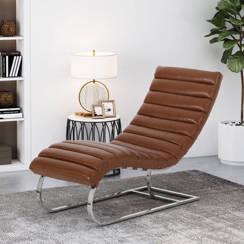 The brown faux leather chair