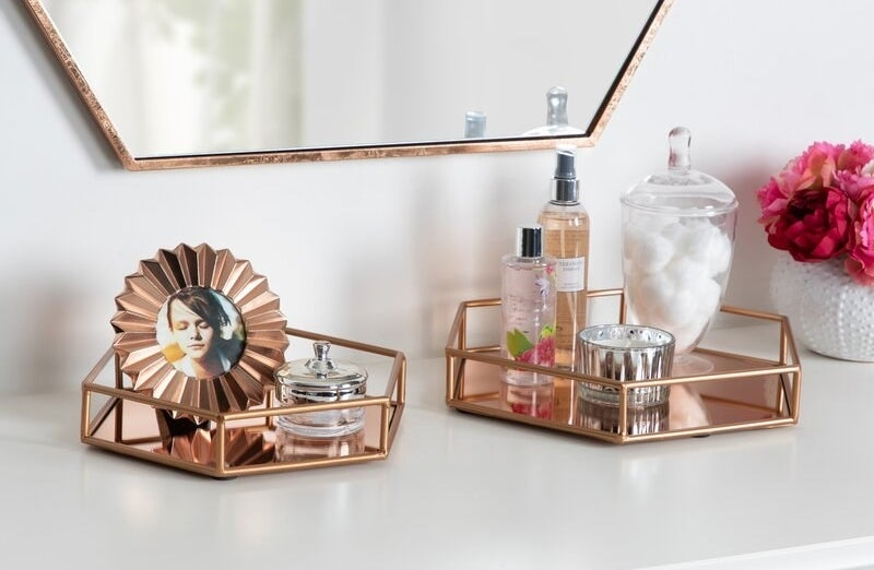 A set of 2 mirrored geometric rose gold trays