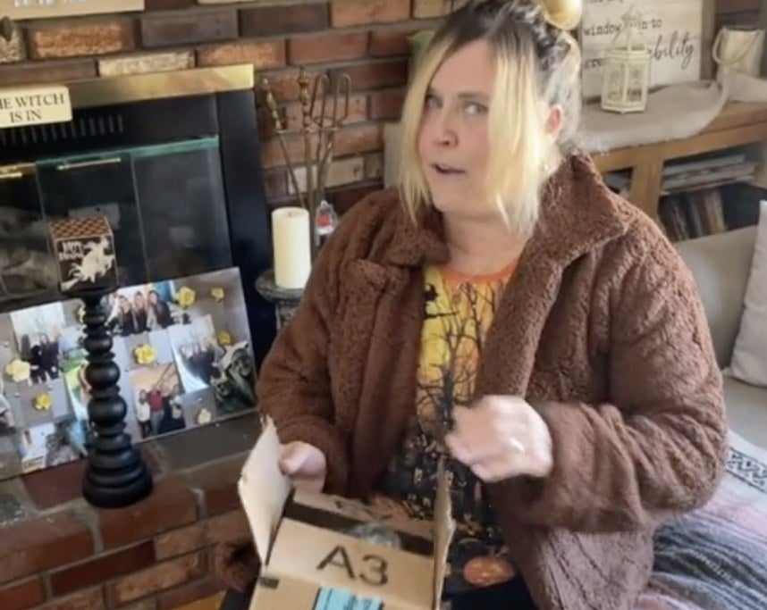 A mom holds an Amazon box
