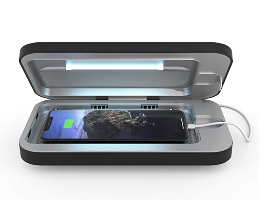 Phone case with light at top and space for a phone at bottom with a charging cord coming out of the side
