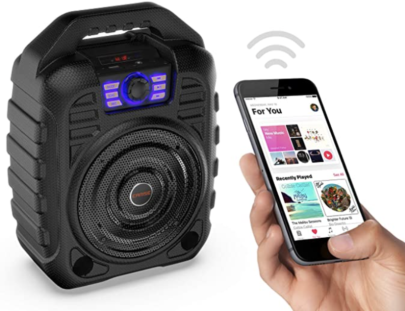 Industrial-looking speakers and a phone with Apple Music up