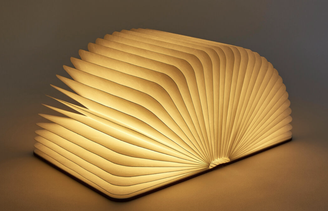A light that's opened into the pages of a book