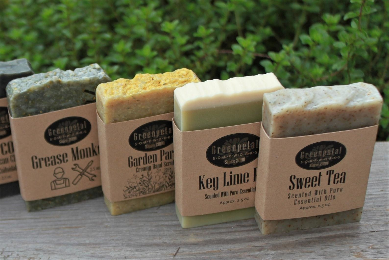 four soaps lined up that are named grease monkey, garden party, key lime, and sweet tea