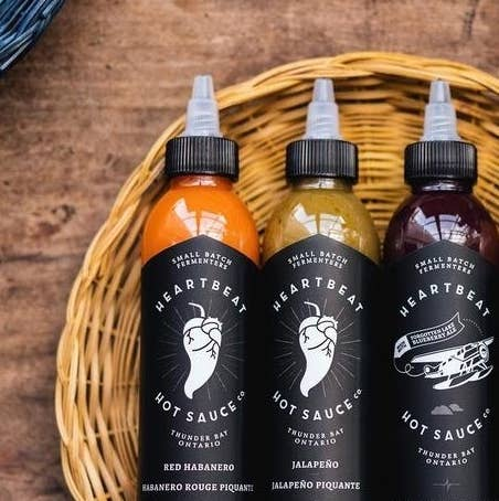 Three hot sauces on a wicker basket