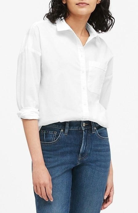 model wearing white button down