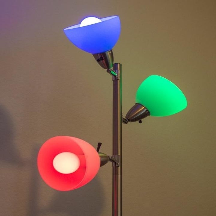 A reviewer's photo of the lights set to blue, green, and red