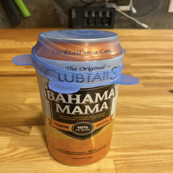 Reviewer image of lid stretched over an open can
