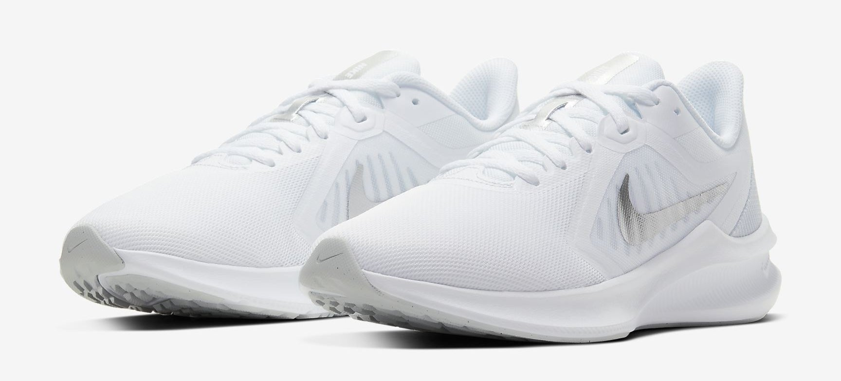 A pair of running shoes on a plain background