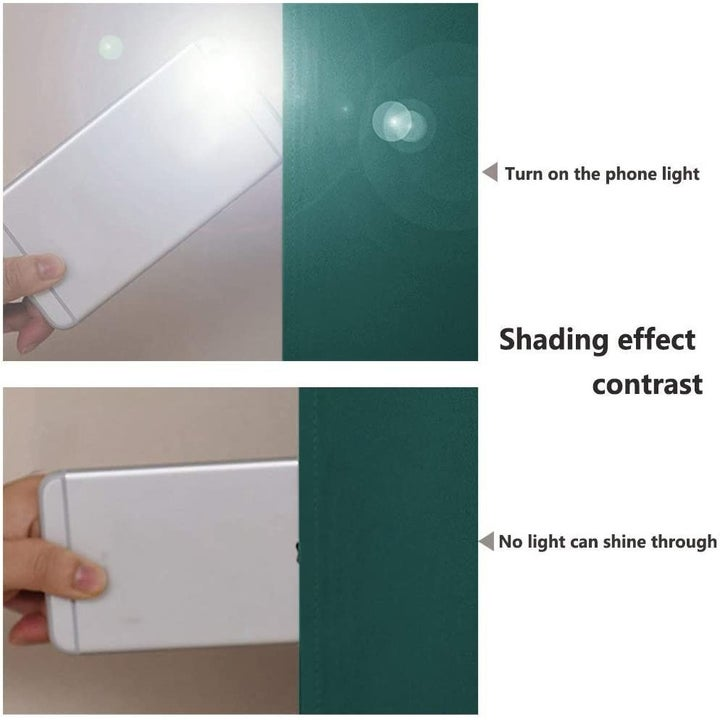 A hand holding a smartphone with a flashlight on to show how light goes right through a normal curtain but not the blackout curtains