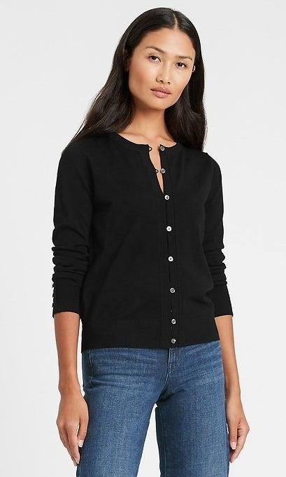 model wearing a black cardigan