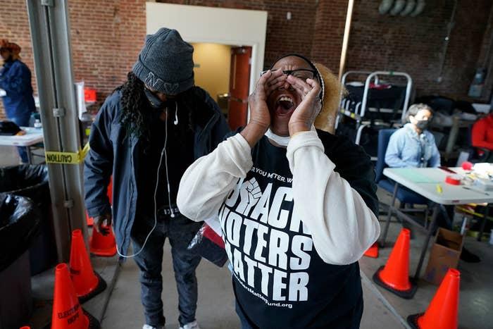 "A black woman wears a shirt that says ""Black Voters Matter"""