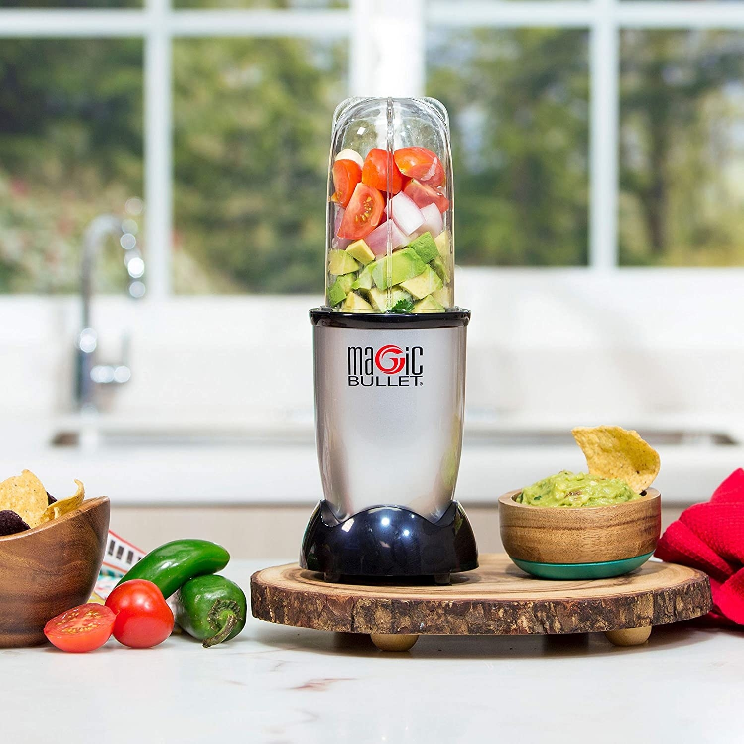 The blender with fruits and veggies inside