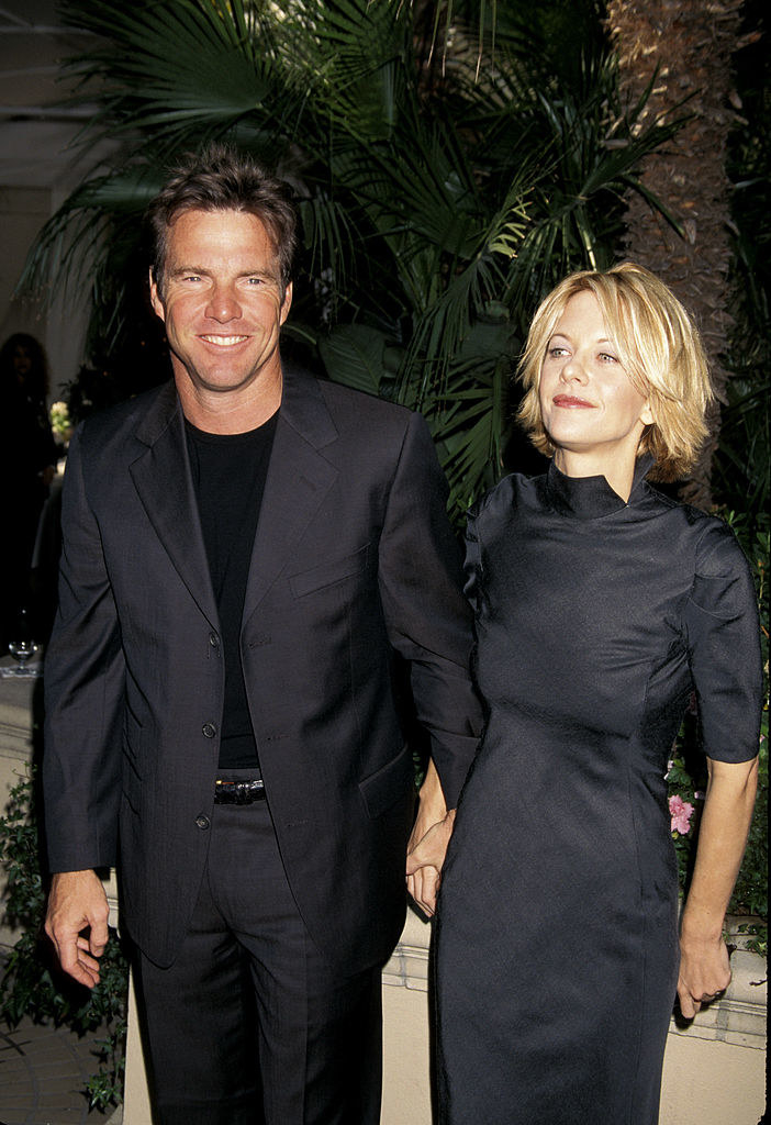 Dennis and Meg holding hands