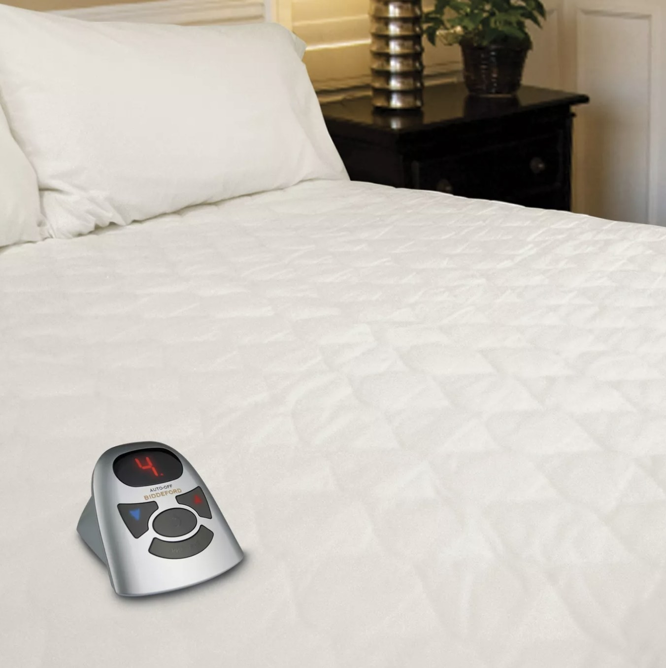 The heated mattress pad on a bed