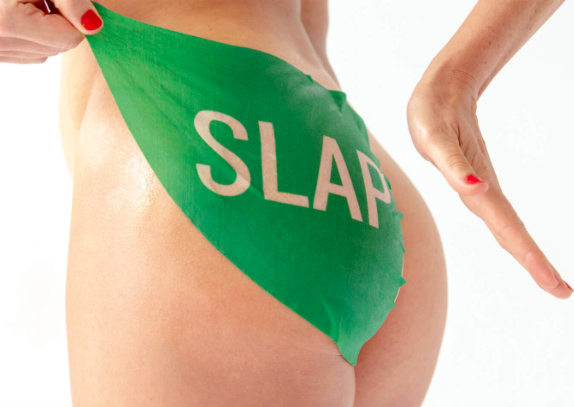 A person wearing the sheet mask on their bum sheet, it says slap on it in large letters