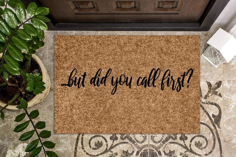 "The ""but did you call first"" doormat in front of a door"