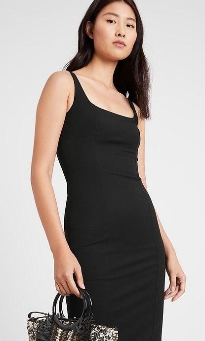 model wearing black bodycon dress