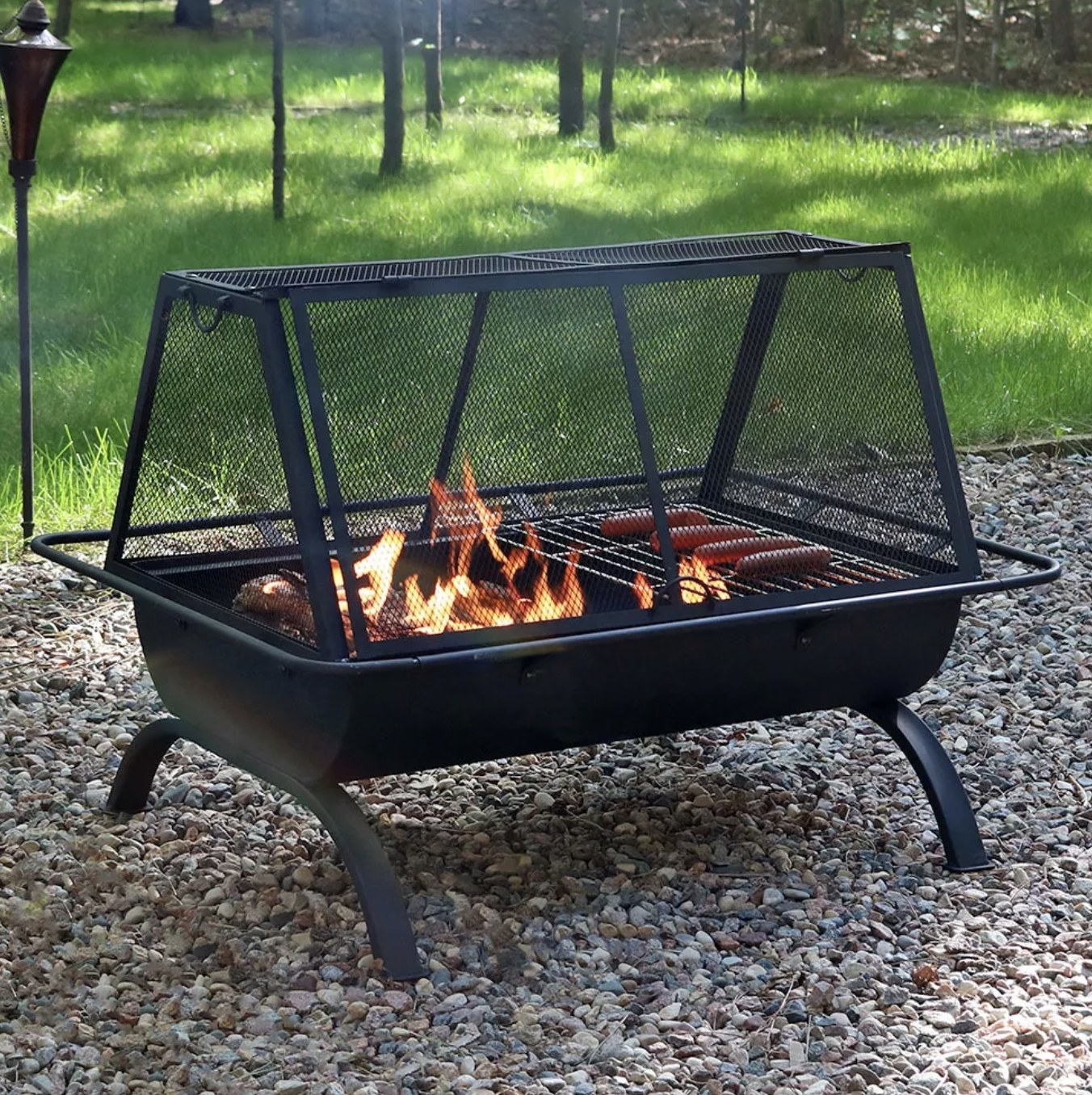 The fire pit with cooking grate on top