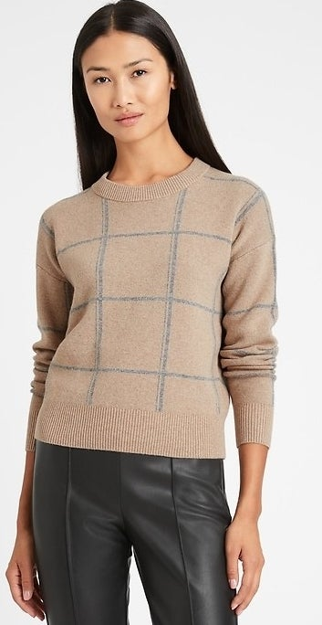 model wearing tan sweater with grey details