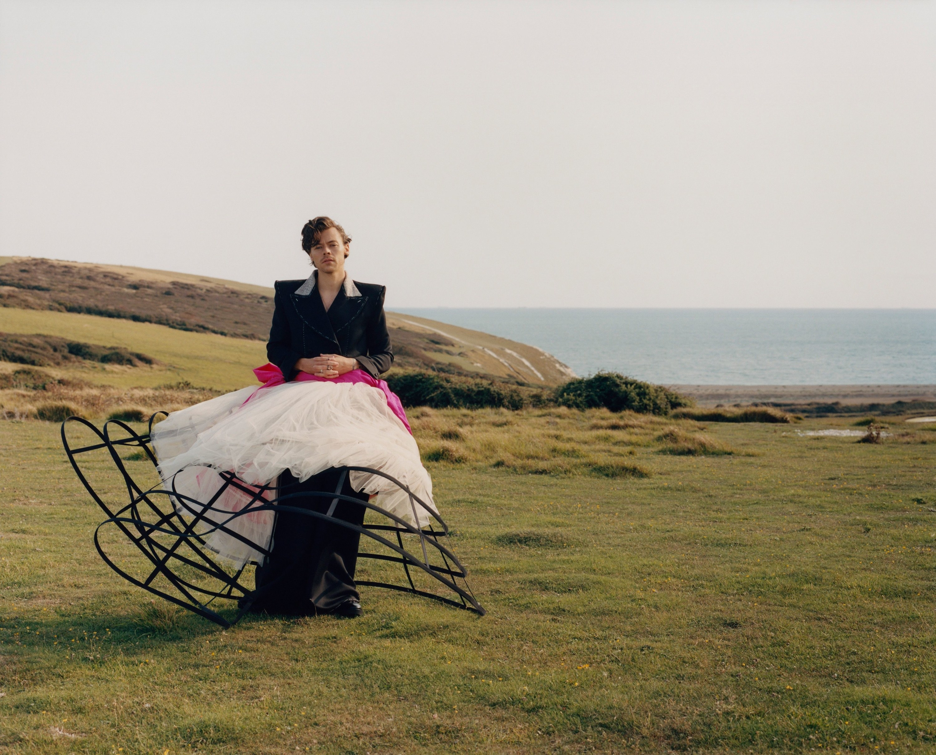 Harry dressed in a full suit, tulle skirt, and a crinoline