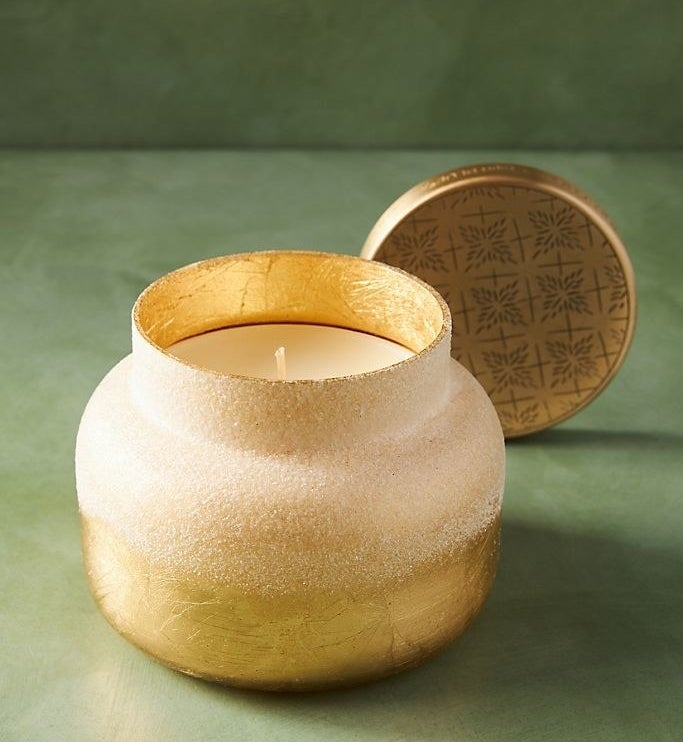 Candle in textured gold and white paint jar with lid