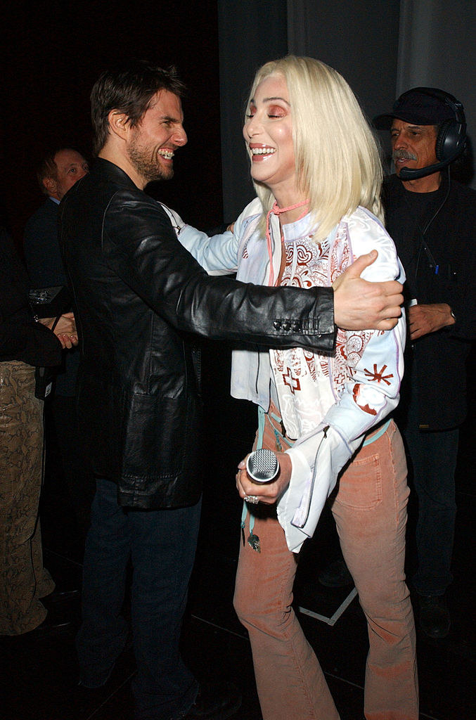 Tom Cruise and Cher laughing and embracing