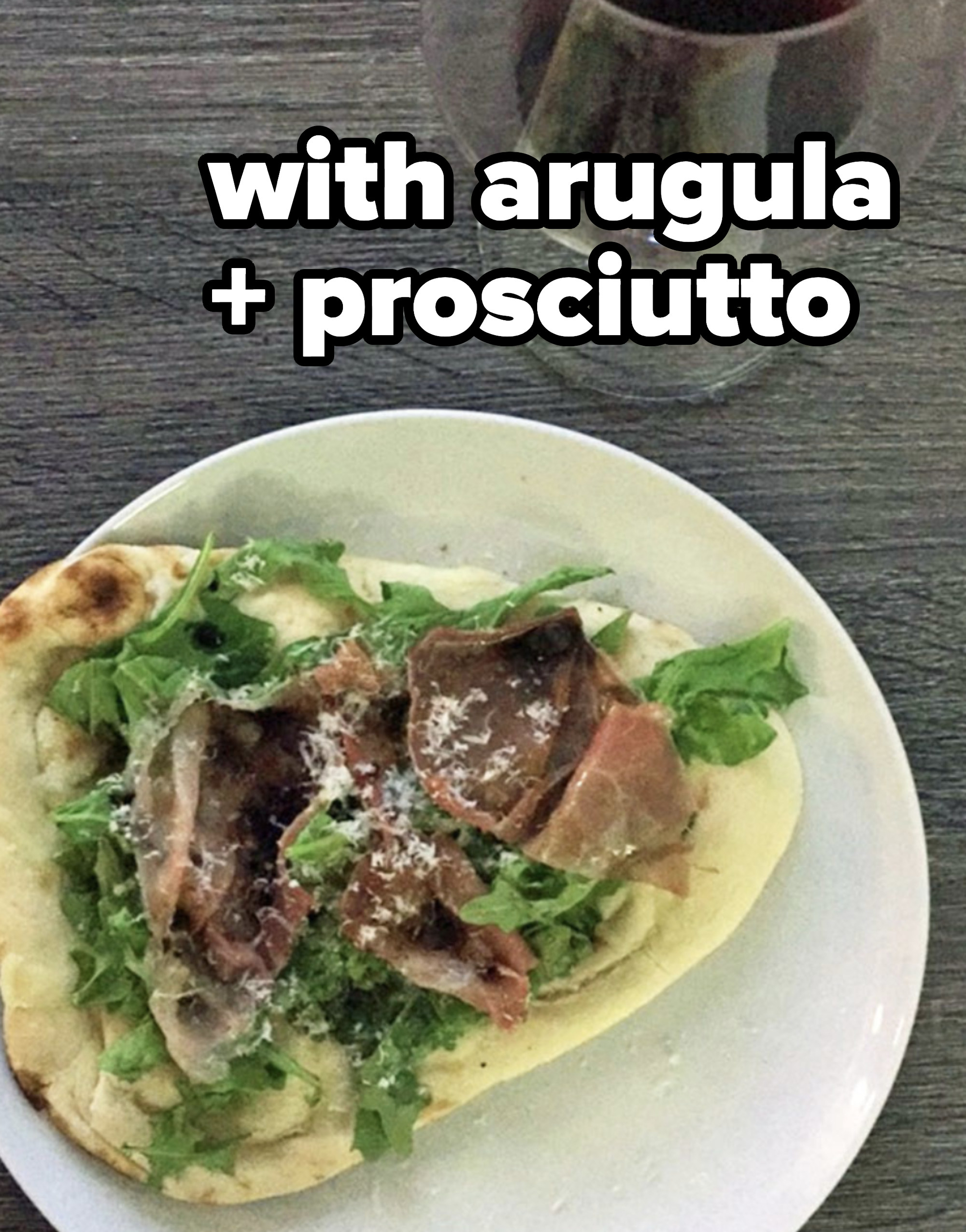 Naan pizza with arugula and prosciutto