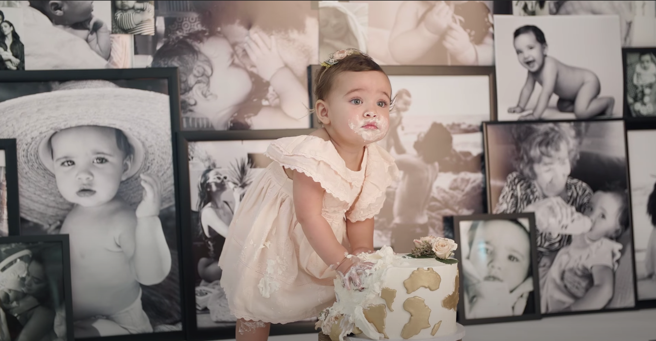 Atlas wears a dress and has birthday cake all over her face for her photo shoot