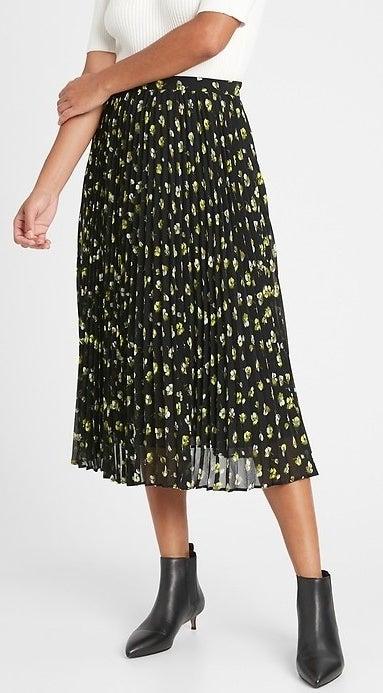 model wearing floral midi skirt