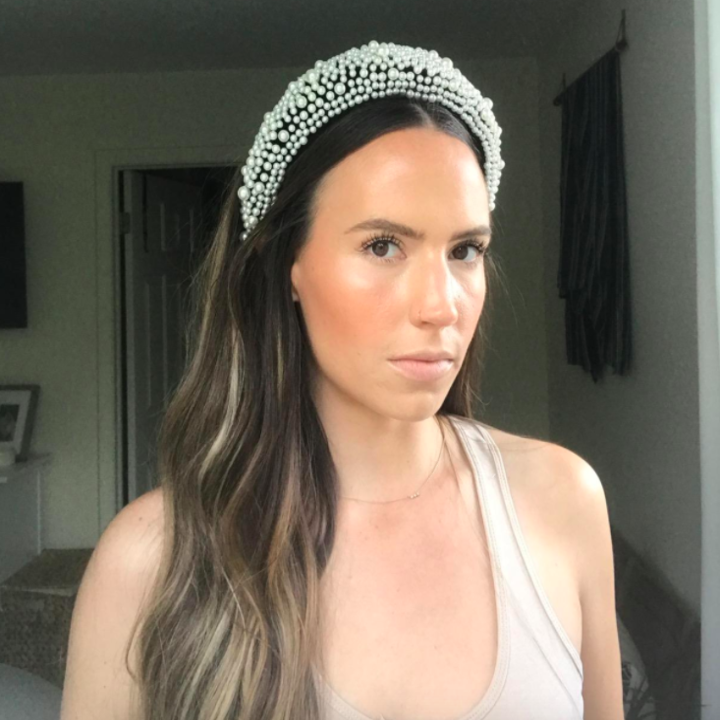 A customer review photo of them wearing the headband.