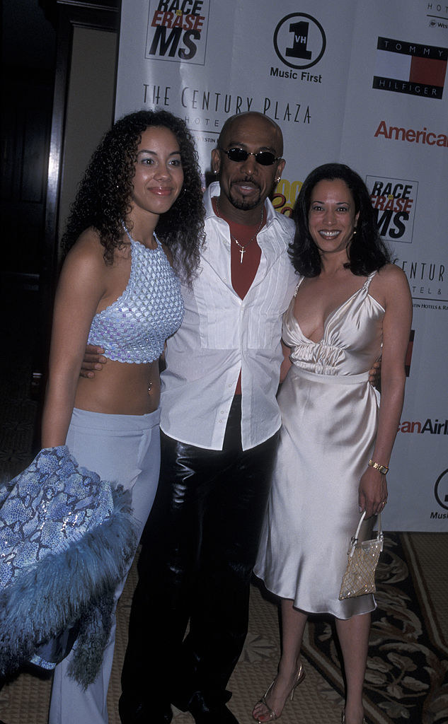 Montel's daughter, Montel, and Kamala posing at the event