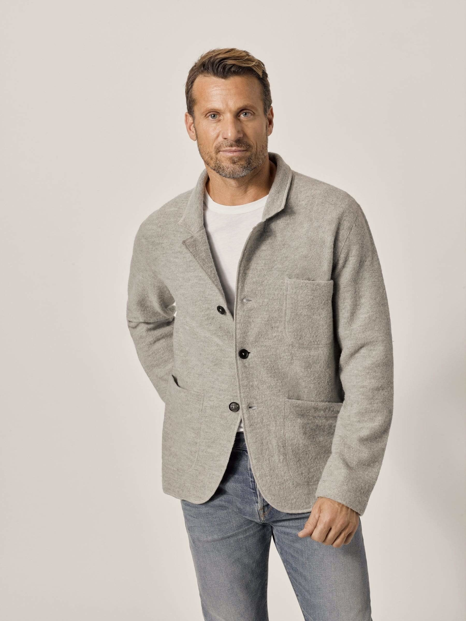 A model wearing the chore coat in the color ash