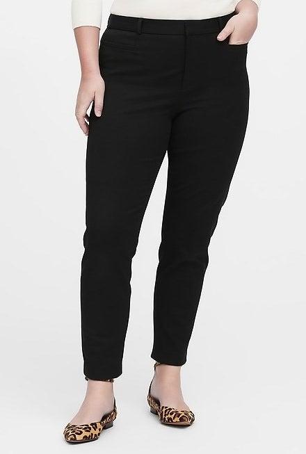model wearing the black trousers