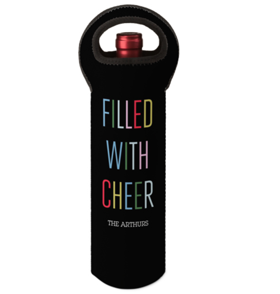 a black neoprene wine tote with a handle and the words filled with cheer on it in different colors