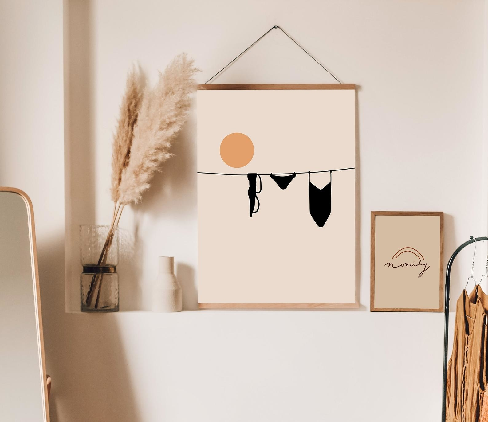 The clothes line art print hanging on a wall