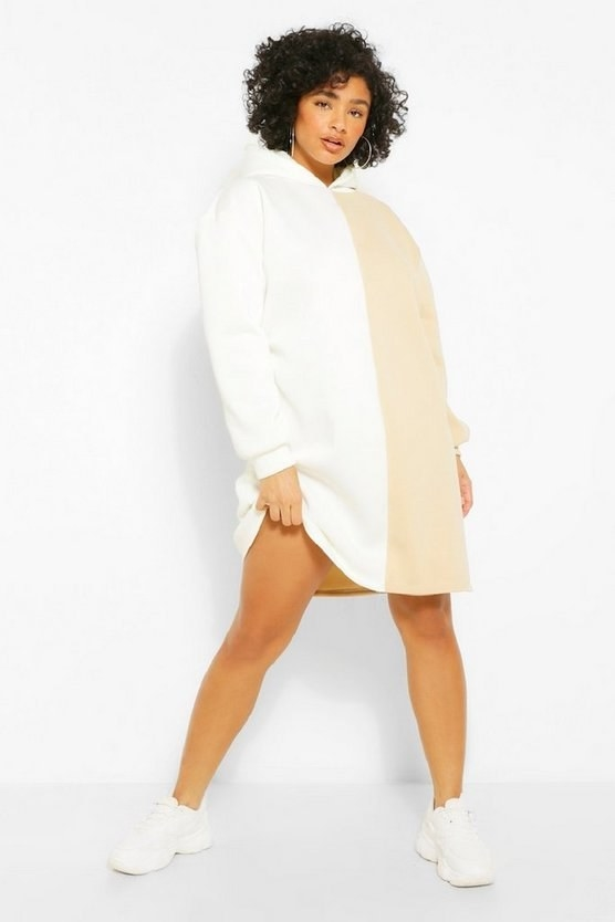 Model wearing white and tan colorblock dress