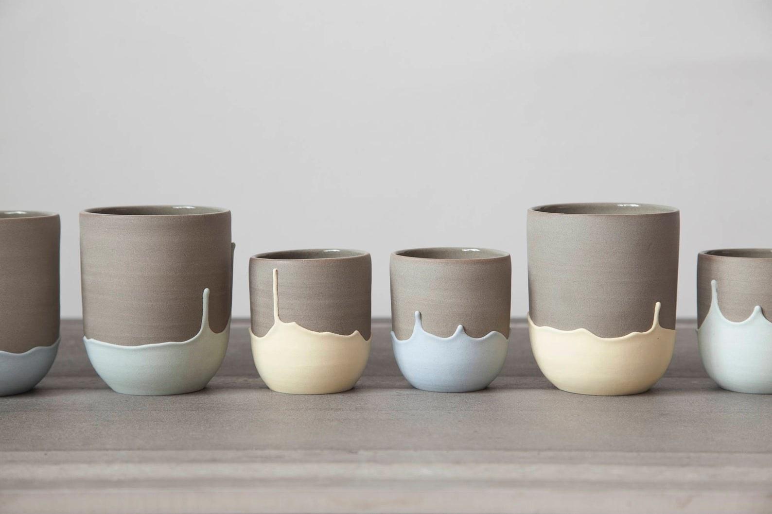row of six mugs with upside down drip pattern