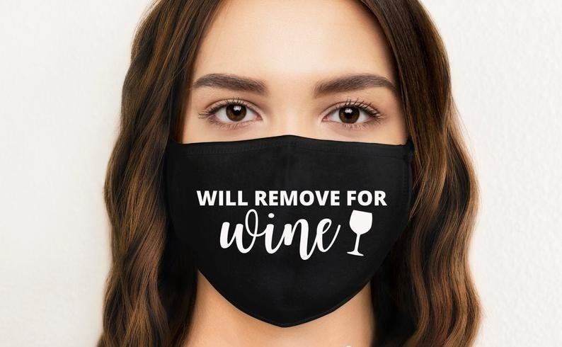 A face mask that says will remove for wine