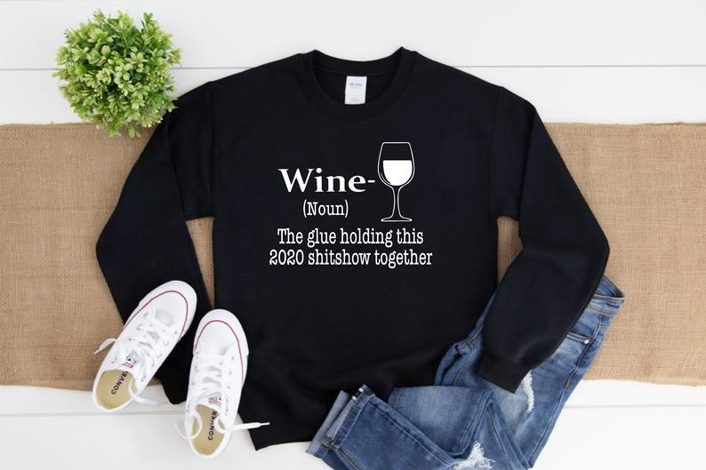 A sweater that says wine noun the glue holding this 2020 shitshow together