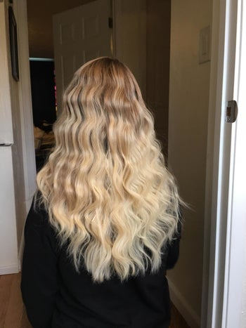 The same reviewer with wavy hair after using the tool