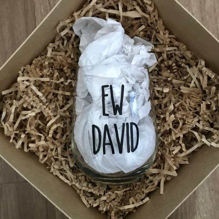 A wine glass that says Ew David