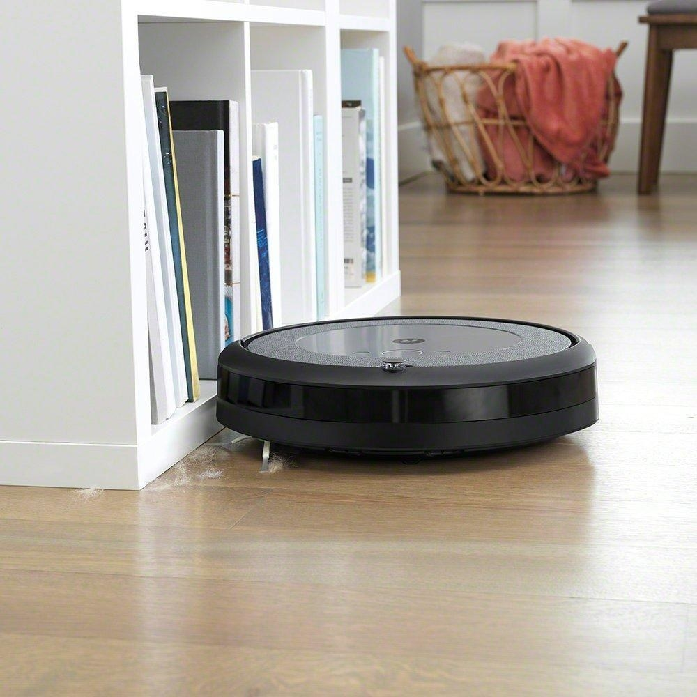 the roomba i3+ vacuuming a living room floor