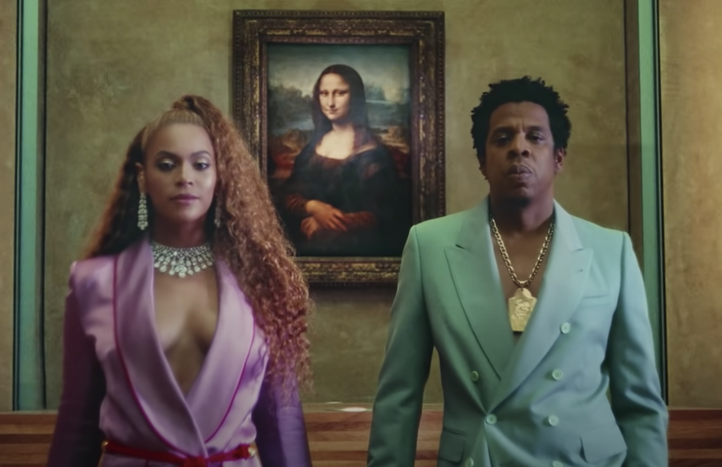 Beyoncé and  Jay Z stand side by side in the Apeshit video
