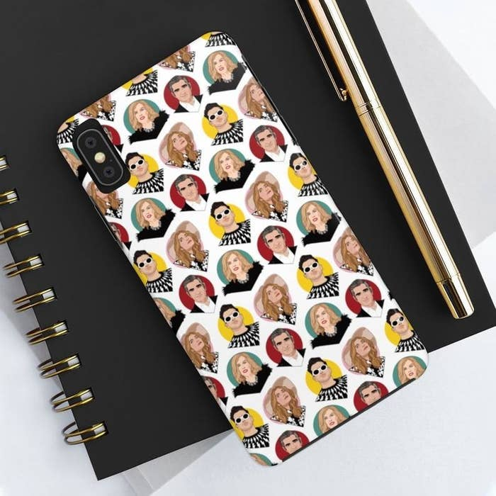 The white, green, red, yellow, and pink phone case printed with the faces of Johnny, Moira, David, and Alexis