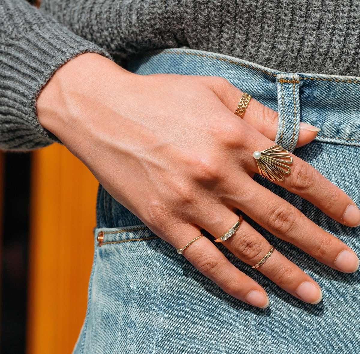 model wearing the gold ring