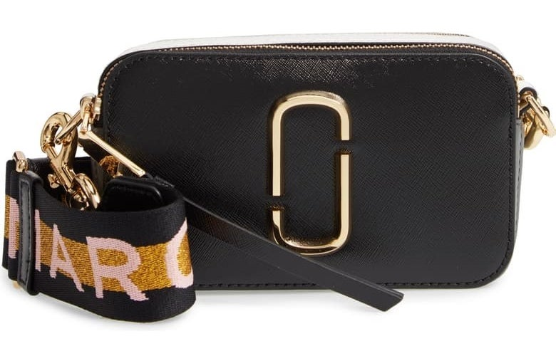 the black purse with multi-colored strap