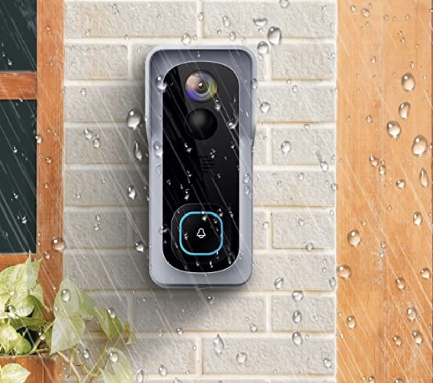 A doorbell camera on the wall with raindrops falling around it